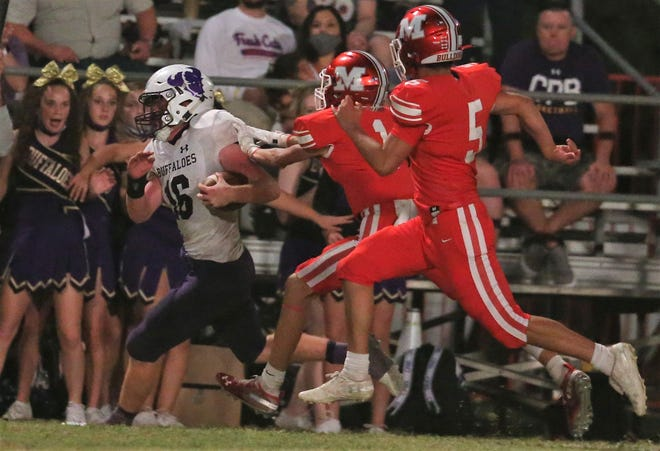 Cross Plains High School quarterback Cody McWilliams is pursued by Miles' Hayven Book, center, and Jose Castaneda at Gary Krejci Memorial Stadium in Miles on Friday, Sept. 25, 2020.