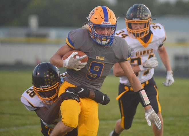 Alcester-Hudson's Owen Bovill is brought down by Colman-Egan's Weston Miles on Friday, Sept. 25, in Alcester.