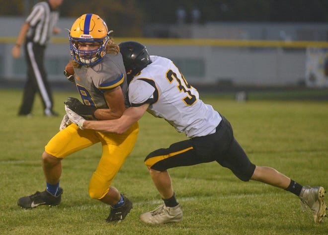 Alcester-Hudson's Kolby Schiefen is brought down by Colman-Egan's Cole Hannasch on Friday, Sept. 25, in Alcester.