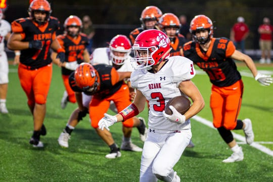 Ozark running back Jake Beets skirts the Tigers' defensive line at Republic high school on Sept. 25