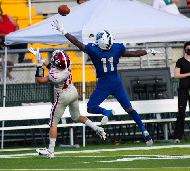 Godby Cougars Kajuan Banks (11) leaps as he tries to intercept the pass intended for Chiles Timberwolves wide receiver Tripp Ragans (15). Godby beat Chiles 32-7 at Gene Cox Stadium Friday, Sept. 25, 2020.
