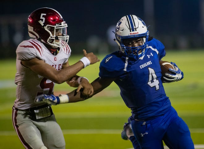 Godby Cougars running back Chase Gillespie (4) pushes off a defender. Godby beat Chiles 32-7 at Gene Cox Stadium Friday, Sept. 25, 2020.
