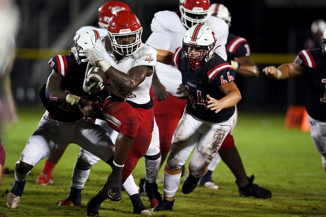 Vero Beach High School's Bobby McMillian moves the ball through the St. Lucie West Centennial defense on Friday, Sept. 25, 2020, ;during a game at South County Stadium in Port St. Lucie. Vero Beach won the game 34-7.