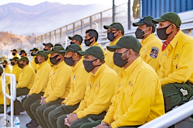 The Sequoia National Forest and Incident Commanders of the Sequoia Complex fires welcomed 100 wildland firefighters from Mexico on Friday, September 25, 2020. About two dozen of the firefighters were able to attend the ceremony at the East Castle Zone Incident Command Post in the Kern Valley High School football stadium near Lake Isabella.