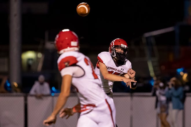 Wausau East's Matt Heinrich (15) throws a pass during the first half against Wausau West during the 51st Log Game on Sept. 25 at Thom Field.