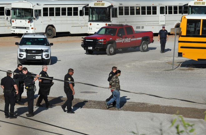 Wichita Falls police detained a woman after she allegedly set a vehicle on fire at the WFISD bus barn Saturday morning.