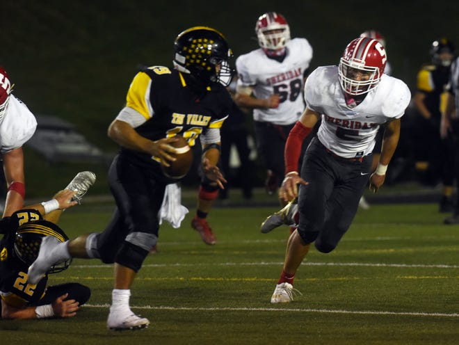 Shay Taylor chases after Aidan Fritter during Sheridan's 33-0 win against Tri-Valley earlier this season. Taylor was named the Division III defensive player of the year by the Southeast District media.