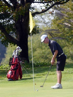 Owen Carney, of Crooksville, putts during last fall's Muskingum Valley League Golf Tournament at Jaycees. Carney will participate in the PGA Management program at Eastern Kentucky.