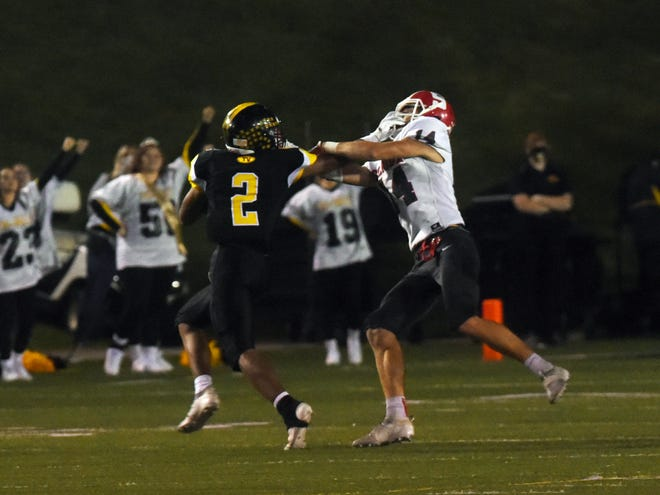 Jordan Pantaleo, of Tri-Valley, left, stiff arms Sheridan's Logan Ranft in a game earlier this season. The Scotties and Generals return to postseason action on Friday night, as Tri-Valley heads to Jackson and Sheridan hosts Columbus South.