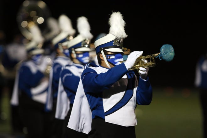 In this file photo, the Zanesville High School marching band performs at halftime against Heath in 2020. This Saturday, ZHS is hosting the Bonanza of Bands on its home turf.