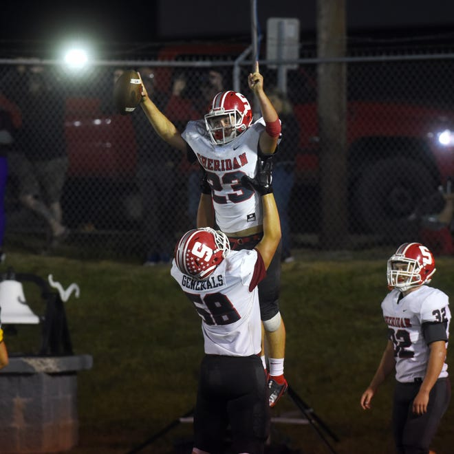 Jason Munyan is hoisted into the air by lineman Holden Bowen after running for a 53-yard touchdown in the third quarter of Sheridan's 33-0 win against host Tri-Valley during a 2020 game at Jack Anderson Stadium. Both players return to lead a General offense with big holes to fill in 2021.