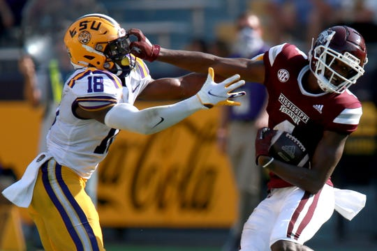Malik Heath breaks off tackle Damone Clark during their SEC matchup in Baton Rouge.