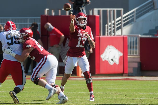 Arkansas Razorbacks quarterback Feleipe Franks (13) throws a pass during the first quarter of the game against the Georgia Bulldogs at Donald W. Reynolds Razorback Stadium.