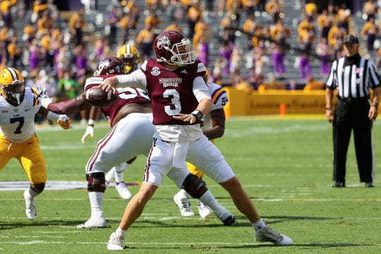Mississippi State quarterback K.J. Costello throws against LSU during the first half at Tiger Stadium.