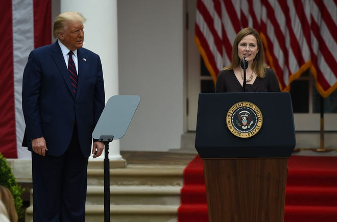 Judge Amy Coney Barrett speaks after being nominated to the Supreme Court by President Donald Trump in the Rose Garden of the White House in Washington, D.C., on Sept. 26, 2020. Barrett, if confirmed by the Senate, will replace Justice Ruth Bader Ginsburg, who died on Sept. 18.