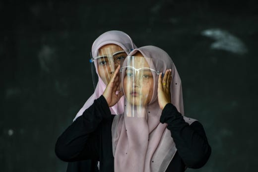 Dancers wearing face shields as a preventive measure against the Covid-19 coronavirus attend a practice session at an art and cultural centre in Banda Aceh on September 26, 2020.
