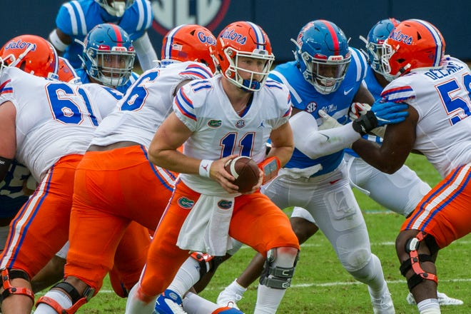 Florida quarterback Kyle Trask (11) prepares to hand off against Ole Miss.