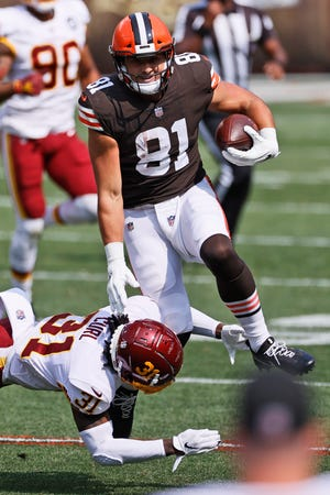 Cleveland Browns tight end Austin Hooper (81) tries to break a tackle by Washington Football Team safety Kamren Curl (31) during the first half of an NFL football game, Sunday, Sept. 27, 2020, in Cleveland. (AP Photo/Ron Schwane)