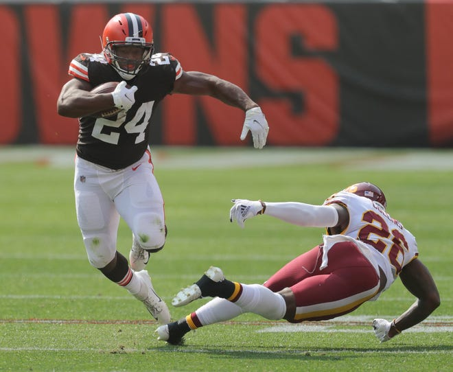 The Browns' Nick Chubb gets past Washington's Landon Collins during a second-quarter run on Sunday in Cleveland.