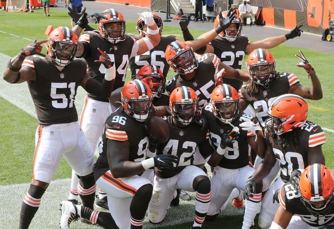 Browns defenders celebrate a second-quarter interception by Karl Joseph against Washington on Sunday.