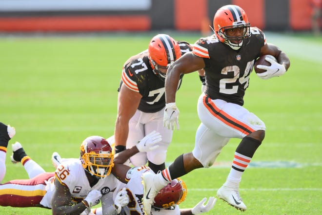 Cleveland Browns running back Nick Chubb rushes for a 20-yard touchdown during the second half of an NFL football game against the Washington Football Team, Sunday, Sept. 27, 2020, in Cleveland. (AP Photo/David Richard)