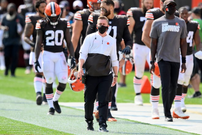 Browns chief of staff Callie Brownson, center, watches during the first half Sunday against the Washington Football Team in Cleveland.
