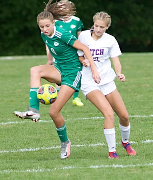 West Branch's Sophia Gregory, left, against Austintown Fitch during a non-conference match at the West Branch Soccer Complex Saturday, September 26, 2020.