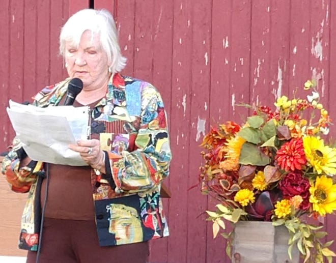 Louaine Leisching, daughter of Ed Taylor, whose family donated the Avain Acres property to the Ashland County Park District, speaks in front of the 1820s vintage barn, the oldest in Ashland County, during the dedication on Saturday.