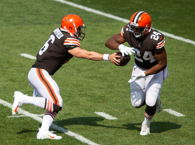 Browns quarterback Baker Mayfield (6) hands the ball off to running back Nick Chubb (24) during the first quarter against the Washington Football Team at FirstEnergy Stadium on Sept. 27, 2020. [Scott Galvin/USA TODAY Sports]