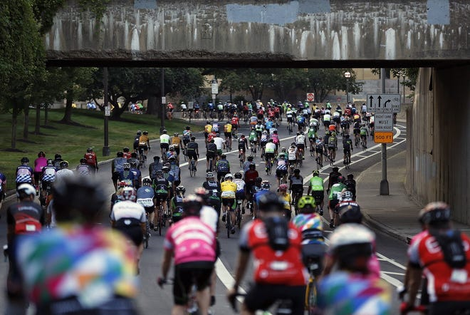 Riders leave the starting line in the Arena District during Pelotonia in 2019. An in-person ride will return this August following a virtual and individualized approach last year.