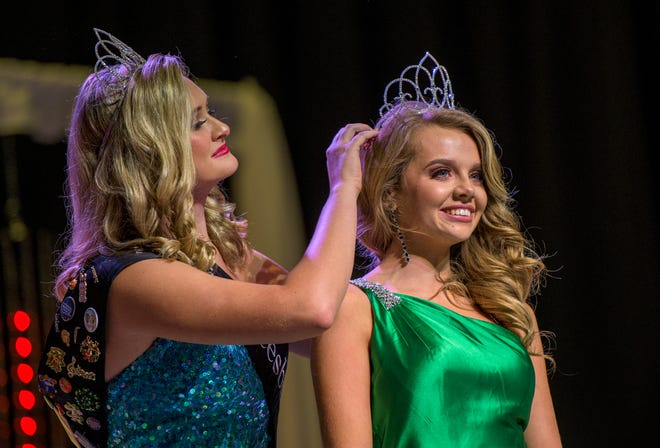 Kamryn Reynolds crowns Riley McDowell at the 34th Annual Miss Leesburg Scholarship Pageant Leesburg High School in Leesburg on Saturday, Sept. 26, 2020. [PAUL RYAN / CORRESPONDENT]