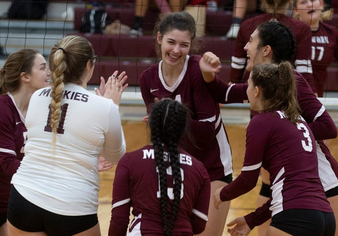 John Glenn players celebrates a point during Saturday's road match at Newark High School. (Jessica Phelps, Newark Advocate)