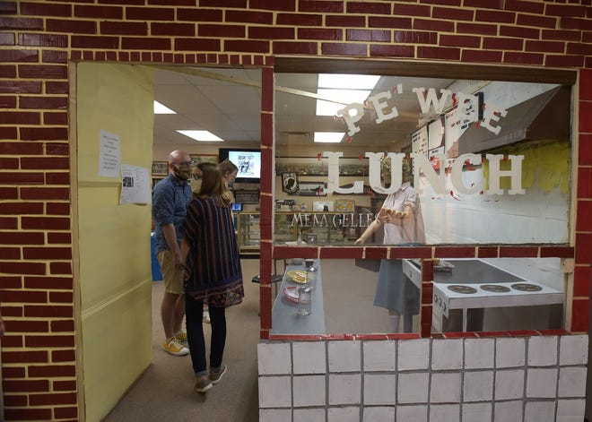 Residents taking a tour through the Pe'Wee Lunch display Saturday at the Ellwood City History Center. The recreation of the lost popular town restaurant will be there through October.