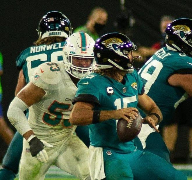 Dolphins linebacker Kyle Van Noy pressures Jacksonville's Gardner Minshew.