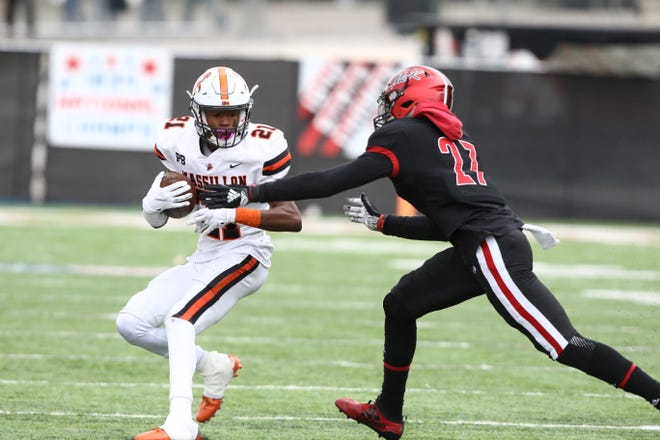 Massillon's Andrew Wilson-Lamp (21) looks to avoid McKinley's Harold Fanin during the two teams' 2019 meeting in Canton.