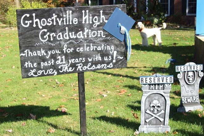 "For 21 years, the Rolsen family on Huntington Road in Hudson set up a ""Ghostville High Graduation"" display on their front lawn during the Halloween season. A group of ghosts are set to receive their diplomas at the graduation ceremony. Pictured is last year's display, which the family said was to be the last."