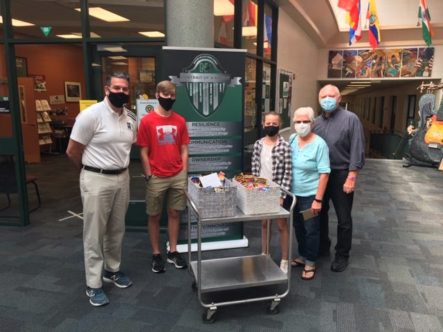 Nordonia High School Principal Casey Wright, left, and Northfield Baptist Church Associate Pastor John Jackson and his wife, Penny, Will Puff and Olivia Puff.