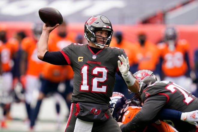 Tampa Bay Buccaneers quarterback Tom Brady throws a pass during the first half  against the Denver Broncos on Sunday in Denver.