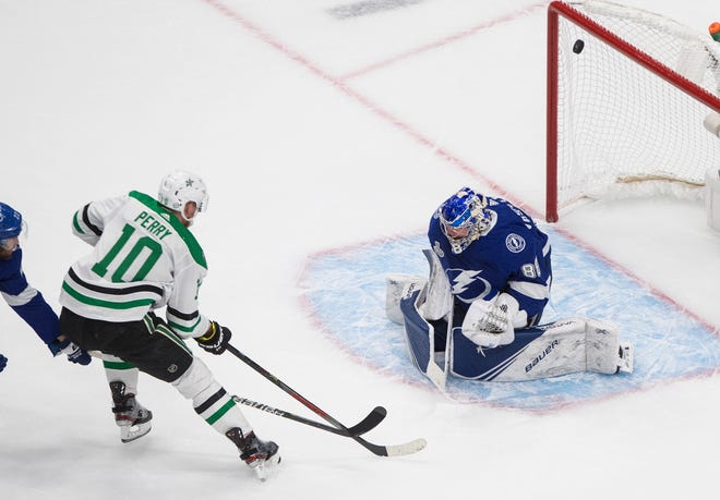 Dallas Stars right wing Corey Perry (10) scores on Tampa Bay Lightning goaltender Andrei Vasilevskiy (88) during the first period of Game 5 on Saturday night.