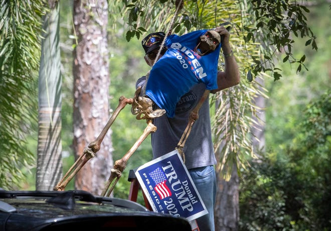 A Jupiter Farms resident thought hanging Presidential candidate Joe Biden from a tree was an appropriate Halloween decoration. His neighbors disagreed and called police. The Vietnam Veteran removed the Biden decorated skeleton from the tree despite no laws being broken Sunday afternoon, September 27, 2020. [ALLEN EYESTONE/palmbeachpost.com]