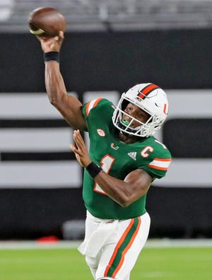 UM quarterback D'Eriq King passes in the first quarter of Saturday night's 52-10 win over FSU. King was 29-for-40 for 267 yards, two touchdowns and no interceptions, and threw passes to 11 different receivers.