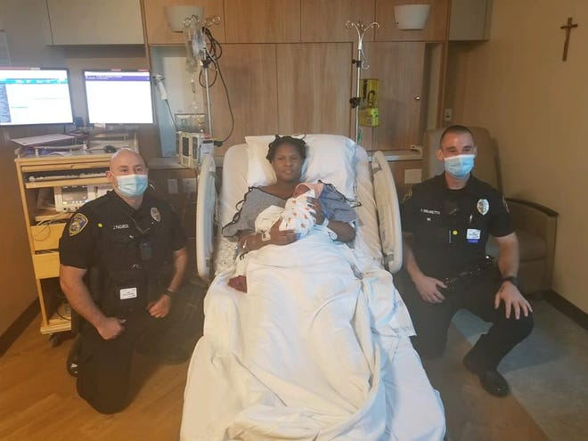 Baby Semaj, doing fine in an area hospital in the arms of his mother, was born Sunday morning in the parking lot outside Stockton police headquarters with the assistance of two uniformed police officers with prior medic experience.