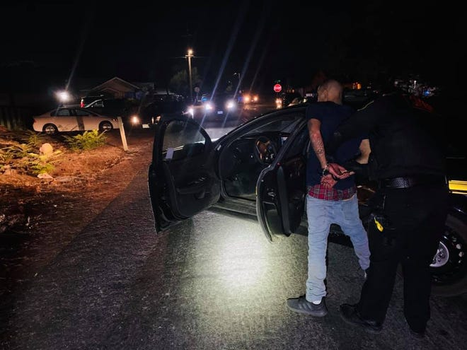Jesus Francisco Alvarado, 30, is placed under arrest by a San Joaquin County sheriff's deputy Friday night on suspicion of numerous felony charges following an alleged vicious attack on his girlfriend in east Stockton.