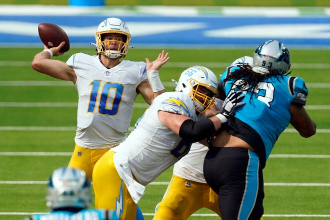 Los Angeles Chargers quarterback Justin Herbert (10) throws against the Carolina Panthers during the second half on Sunday. (AP Photo/Ashley Landis)
