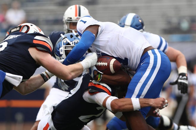 Duke receiver Jontavis Robertson is tackled by Virginia defenders during Saturday's game at Scott Stadium.