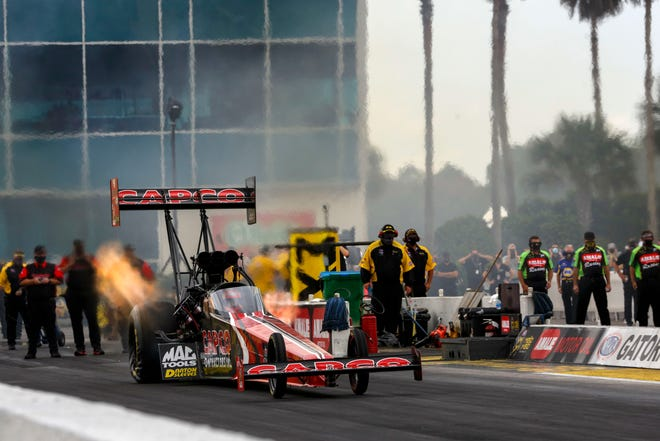 Steve Torrence competes in the Top Fuel dragster division Sunday during NHRA's Gatornationals at Gainesville Raceway. Torrence placed first in the category after defeating his father, Billy, in the final round.