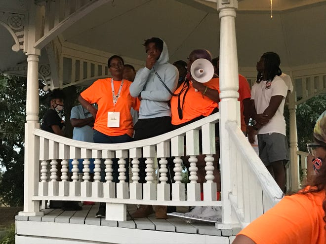 Catrina Merrick supports Jovari Sumpter, as the friend of her late son Allen Merrick spoke to those gathered Saturday to raise awareness about the cost of gun violence. She said since she lost her son, she's gained sons and daughters as his friends have tried to comfort and support her.