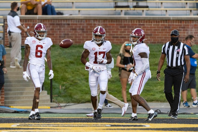 Alabama wide receiver Jaylen Waddle, center, celebrates with teammates DeVonta Smith, left, and John Metchie III, right, after scoring a touchdown during the first quarter of an NCAA college football game against Missouri, Saturday, Sept. 26, 2020, in Columbia, Mo. (AP Photo/L.G. Patterson)