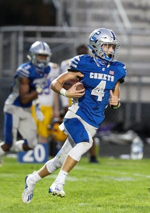 Central Crossing quarterback Alec Boyd carries the ball against visiting Reynolsdburg on Sept. 25. The Comets lost 34-10.