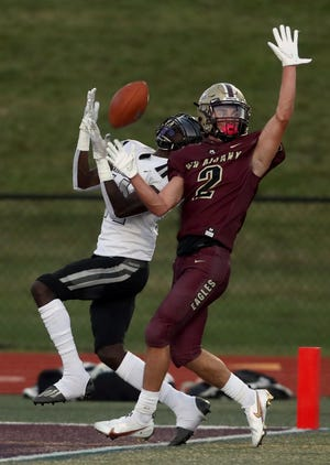 Pickerington North's Carl Allen II hauls in 40-yard touchdown pass as New Albany's Jesse Gordon defends during their game Sept. 25.
